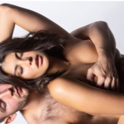 Husband holding wife tightly from behind; MarriageHeat