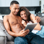 Man and woman reading on tablet together - MarriageHeat
