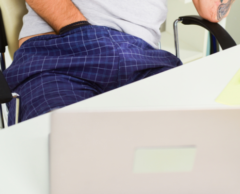 Man with hand in waistband at desk ~ MarriageHeat