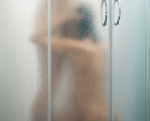 Wife kneeling before husband in the shower ~ MarriageHeat