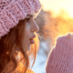 Brunette in pink winter had blows on cold hands ~ MarriageHeat