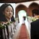 Bride walking down aisle toward groom inset closeup of bride's face - MarriageHeat