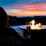 Enjoying a glass of wine at the outdoor fire table ~ MarriageHeat.