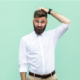 Bearded man scratches head with doubtful look on face ~ MarriageHeat
